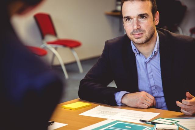 man in suit being interviewed