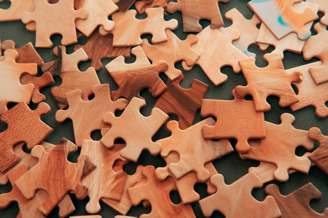 a pile of brown puzzle pieces to illustrate the concept of recruiting